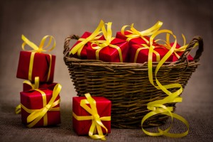 close up basket full of red wrapped gifts
