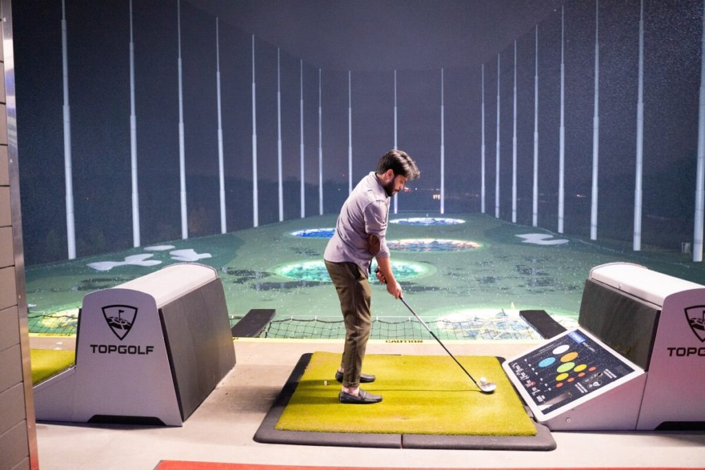 Man Practicing Golf Night