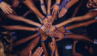 Hands Huddling Successful Fundraiser